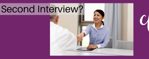 An Asian woman meets with the hiring manager for a second interview