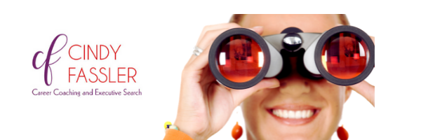 Young woman peering through binoculars searching for a new job.